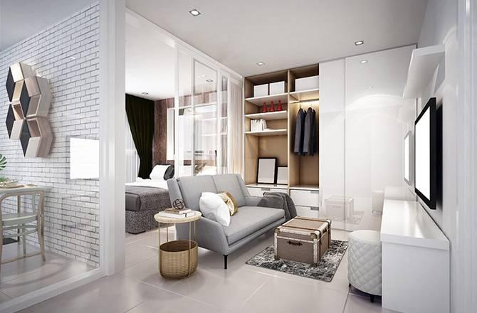 Aménager un petit appartement : la cloison en verre pour laisser passer la lumière
