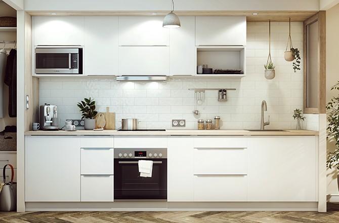 Un plan de travail en bois clair associé à du blanc apportera de la luminosité à la cuisine.