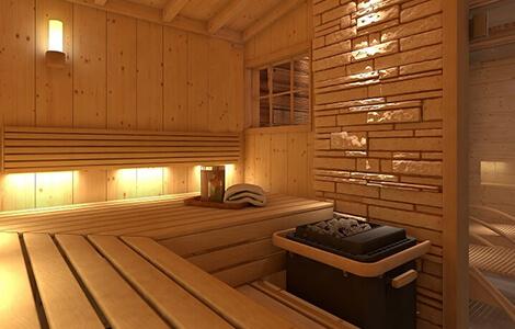 Le sauna finlandais en bois avec bancs et pierres volcaniques