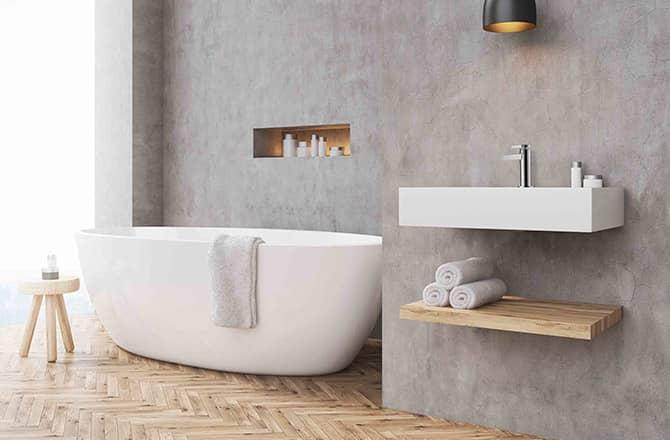 Une salle de bains contemporaine avec murs en béton ciré