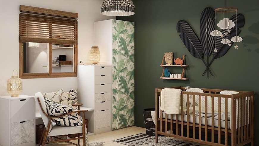 Une chambre d'enfant au mur vert foncé